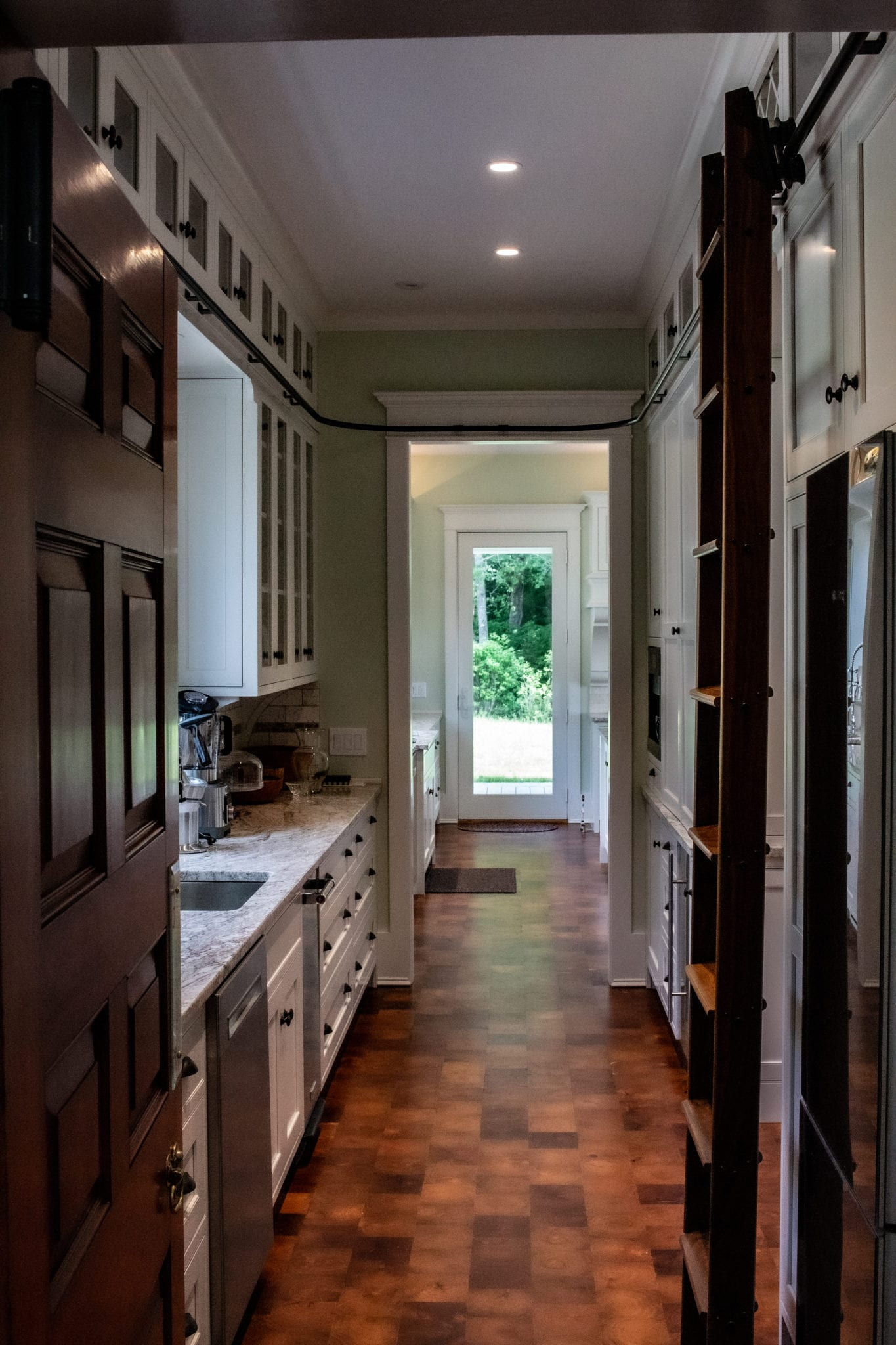 Pantry area with rolling ladder